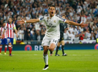 Javier Hernandez scores against Atletico Madrid