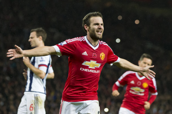 Manchester United's Juan Mata, centre, celebrates after scoring during the English Premier League soccer match between Manchester United and West Bromwich Albion at Old Trafford Stadium, Manchester, England, Saturday, Nov. 7, 2015. (AP Photo/Jon Super)