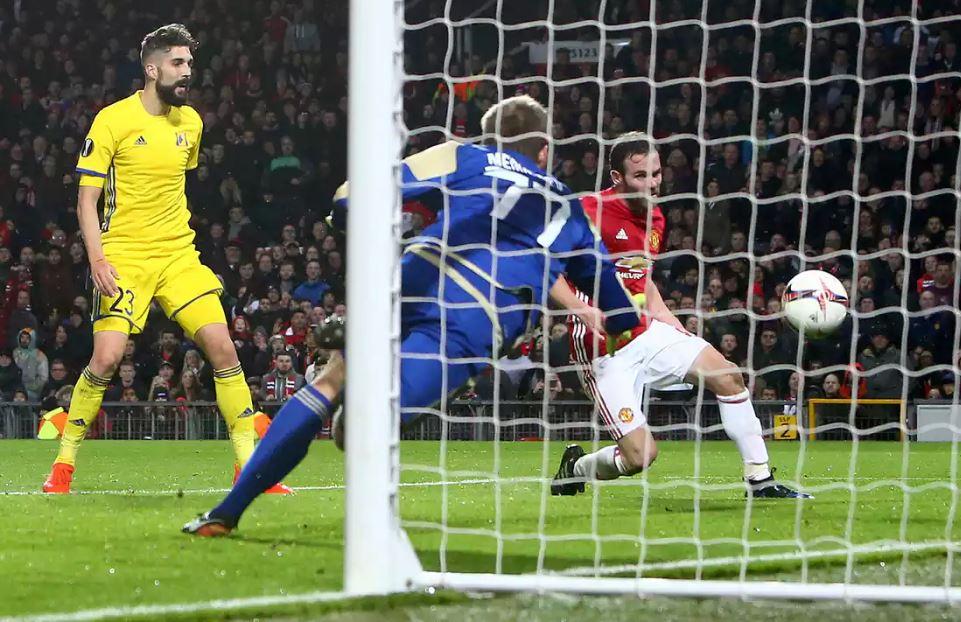 Juan Mata slips a goal, not a banana, past FC Rostovs Nikita Medvedev.