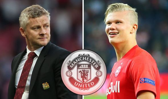 Photo Man Utd Fans React As Erling Haaland Appears To Sign Mufc Shirt